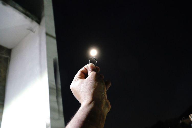 Cropped hand holding illuminated lighting equipment