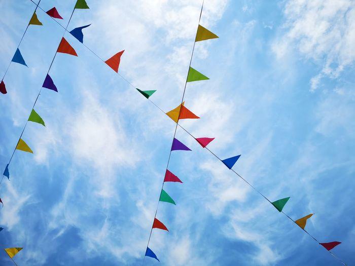 Party flag on the wind Unity Blue Multi Colored Celebration Celebration Event Sky Cloud - Sky Triangle Shape Pyramid Shape Flag Wind