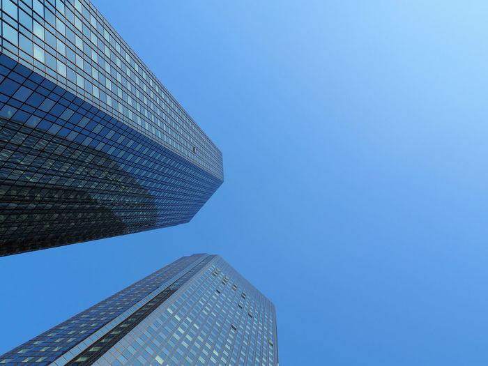 Architecture Blue Building Exterior Built Structure City Clear Sky Day Financial District  High Low Angle View Modern No People Outdoors Sky Skyscraper Tall - High Tower Two