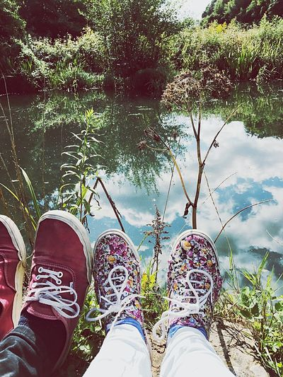 Personal Perspective Person Water Shoe Lake Tree Footwear Grass Plant Leisure Activity Friendship Relaxation Relaxing Lakeshore Tranquility Reflection Outdoor Photography Captured Moment Pose Romance Shoes Two Is Better Than One Human Foot Feet Shoes ♥
