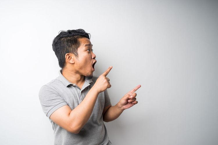 Man smoking cigarette against white background