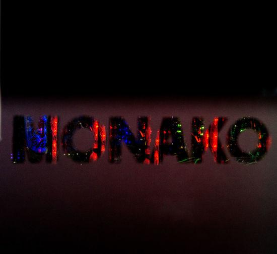 Close-up of illuminated text on wall at night