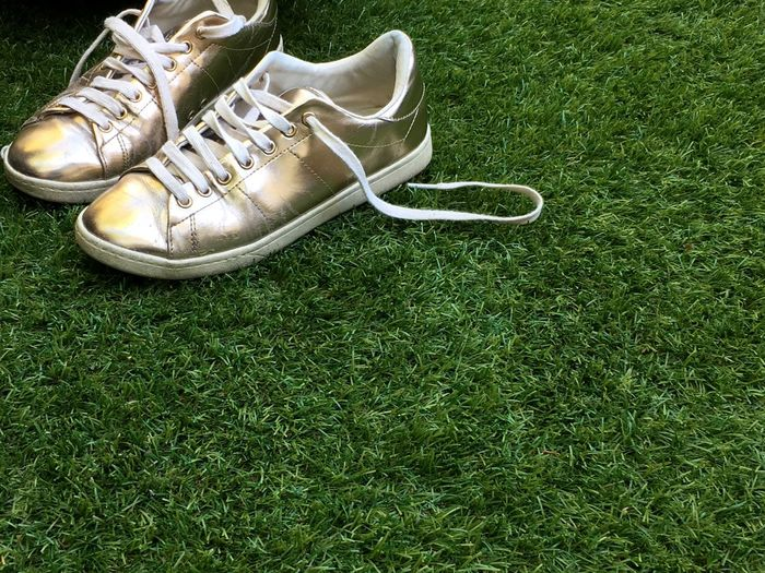 High angle view of shoes on grassy field