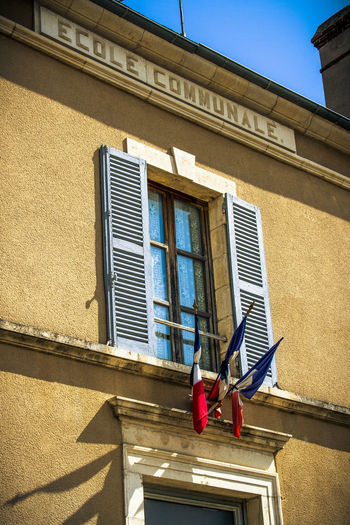 Architecture Building Building Exterior Built Structure Day Flags France Low Angle View No People Outdoors School Sunlight Window Windows