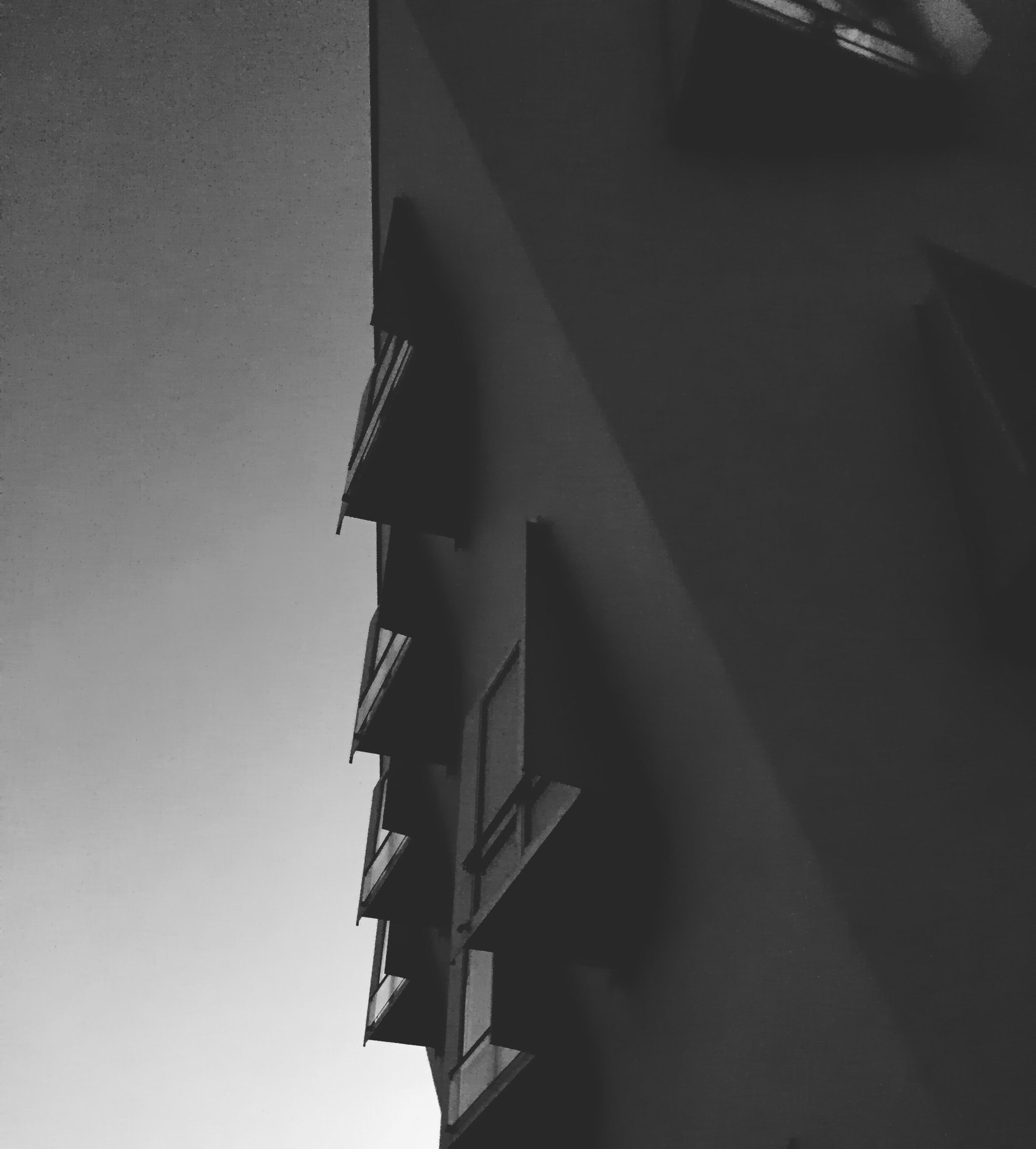 architecture, built structure, building exterior, low angle view, building, one person, shadow, wall - building feature, city, copy space, part of, residential building, window, indoors, residential structure, sunlight, day, house, cropped