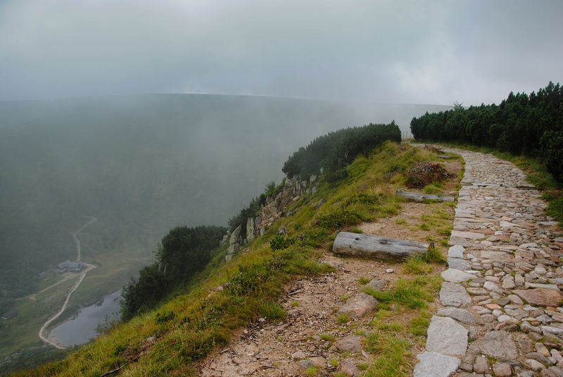 Mountain trail at the edge of the cliff Cloudy Freedom Hiking Karkonosze Misty Mountain Trail Mountain View Sudety Trekking Beauty In Nature Cliff Day Hiking Adventures Hiking Trail Landscape Love Mountains Mistery Atmosphere Mountain Mountains And Sky Nature No People Outdoors Slope Steep