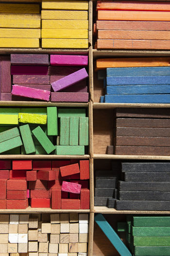 Colorful cuisenaire rods. Mathematics learning aids for students. Mathematical concepts. Blocks Box Learning Shapes Thinking Arrangement Calculate Choice Close-up Colorful Concept Design Education Equipment Indoors  Large Group Of Objects Mathematics Multi Colored No People Object Sticks Still Life Variation Wood - Material Wooden