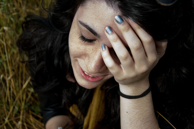 Close-Up Of Sad Woman On Field
