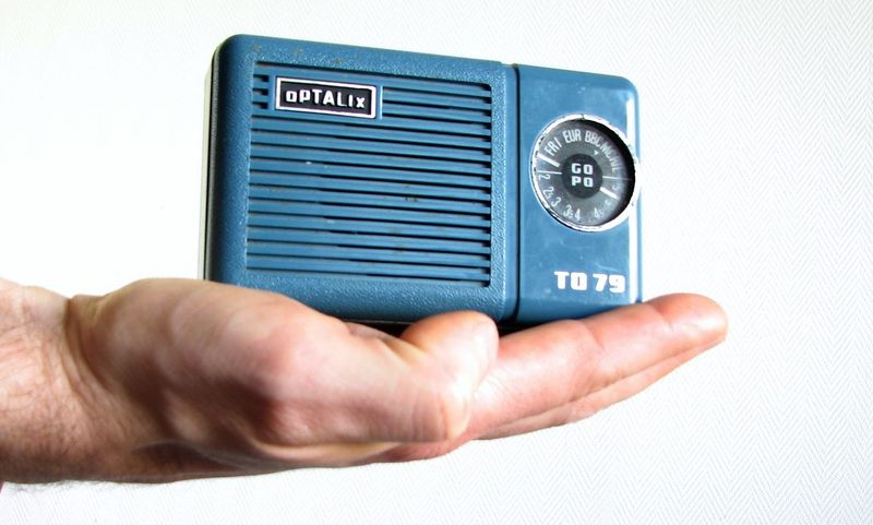 A radio. 1969 Communication Detail Holding Human Hand Made In France Optalix Radio Single Object Technology The Enhanced Human Vintage Visual Trends SS16 - Technology Everywhere