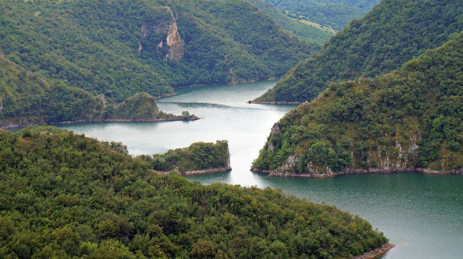 Beautiful curves on Uvac river canyon in Serbia Curves Serbia Beauty In Nature Canyon Day Forest Green Color Lake Landscape Mountain Mountain Range Nature No People Outdoors River Scenics Uvac Water