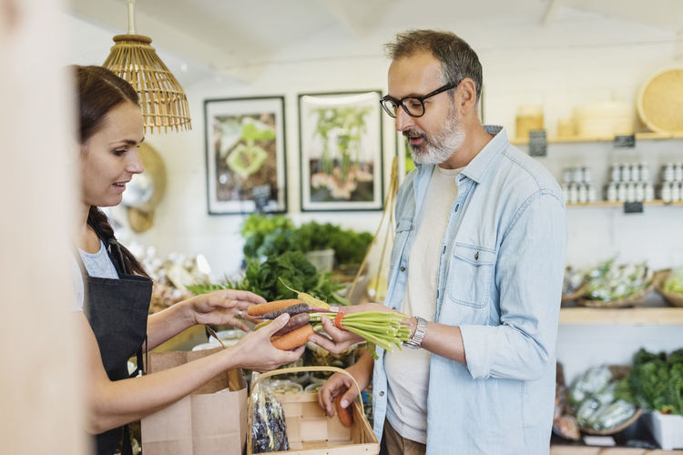 Man holding woman standing at store