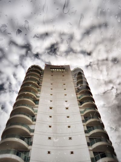 After The Rain Architecture Building Exterior Built Structure City Cloud - Sky Cloudy Crystal Day Drop Low Angle View Modern Nature No People Nublado Outdoors Rain Sky Skyscraper Tower Window