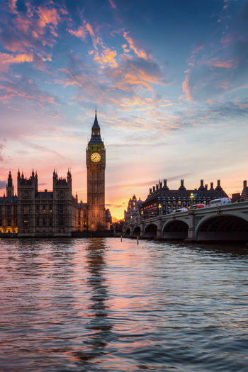 The Big Ben clocktower at Westminster in London during a calm sunset Architecture River Sky Water City Bridge Waterfront Travel Destinations Government Outdoors Building Cloud - Sky Sunset Built Structure Big Ben London Thames River Westminster Calm Tranquility City Urban Tourist Attraction  United Kingdom Landmark