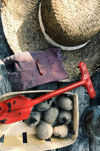 Directly above shot of potato gardening equipment on wooden table