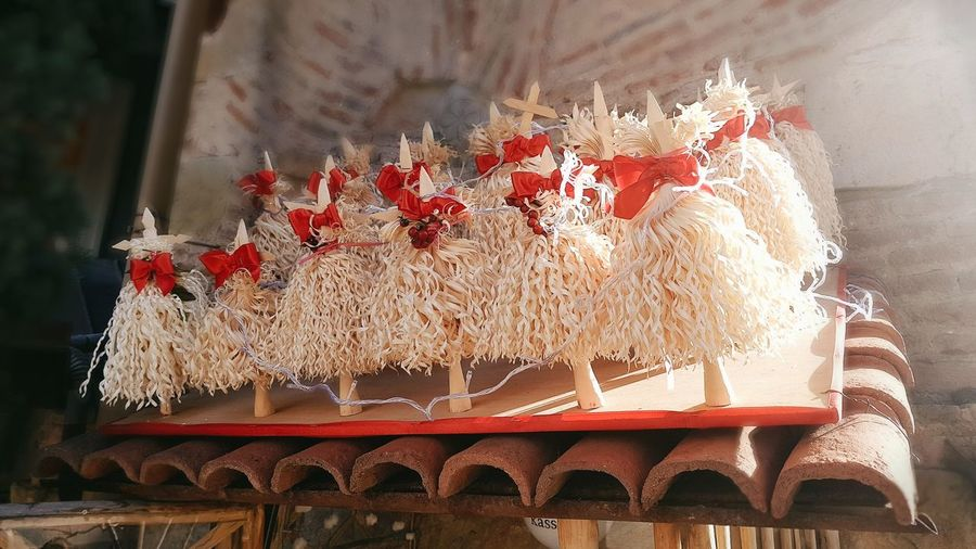 Chichilaki - Georgian traditional Christmas tree made with nut's peeled branches. Tbilisi Tbilisi Georgia Red Christmas Decoration Christmas Tree White Color Art Is Everywhere Sunny Day Streetphotography