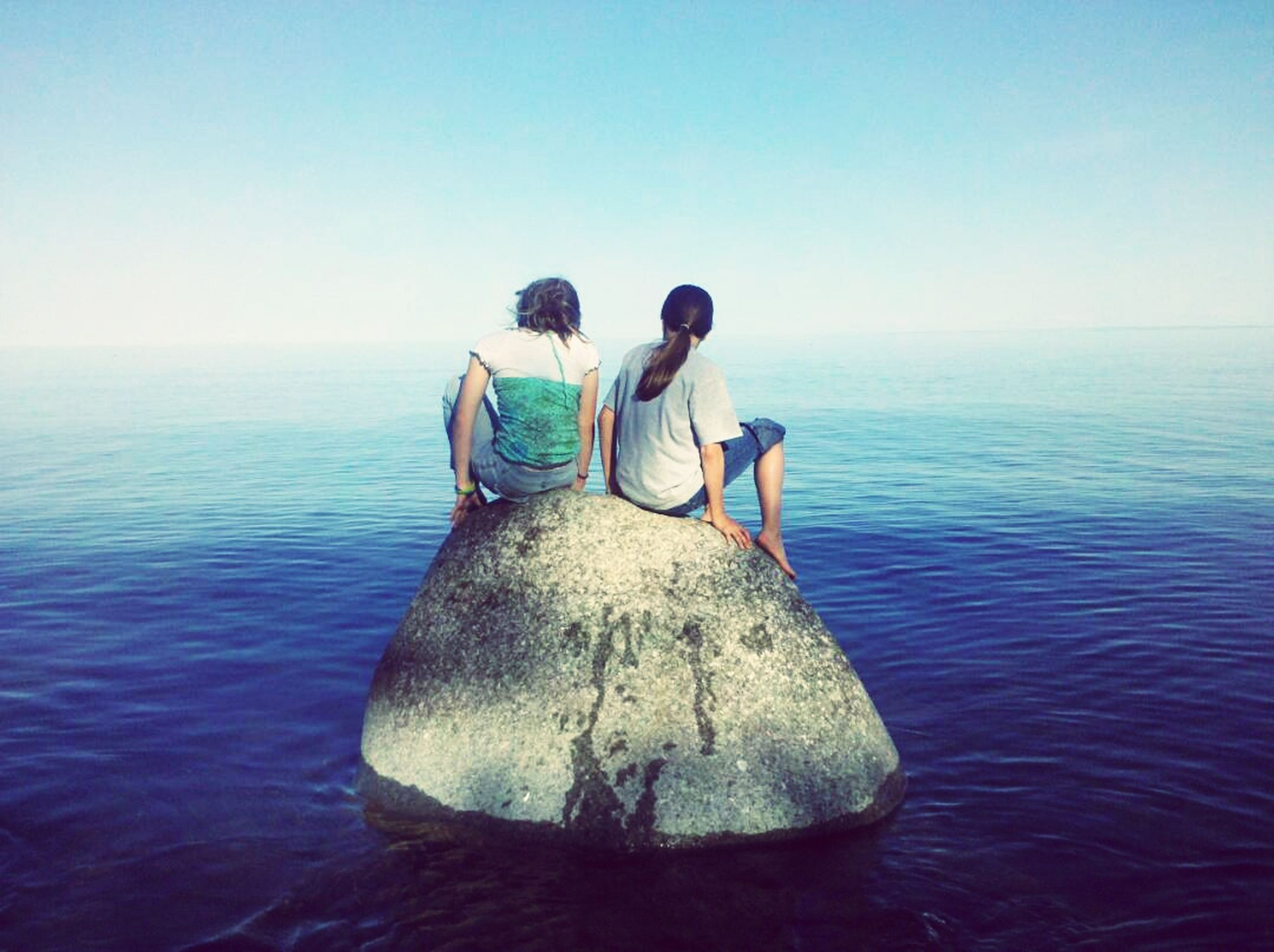 water, sea, rear view, horizon over water, leisure activity, lifestyles, tranquility, tranquil scene, blue, clear sky, men, scenics, nature, beauty in nature, waterfront, rippled, full length, sky