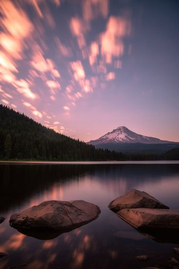 Summer Sunset in motion over Mt Hood and Trillium Lake, Oregon Outdoors Travel Summer Pristine Trillium Lake Oregon Beauty Pacific Northwest  Landscape Long Exposure Mt Hood Oregon Water Lake Sky Scenics - Nature Reflection Beauty In Nature Tranquil Scene Tranquility Mountain Tree Nature Cloud - Sky No People Mountain Range Waterfront Idyllic Non-urban Scene Sunset