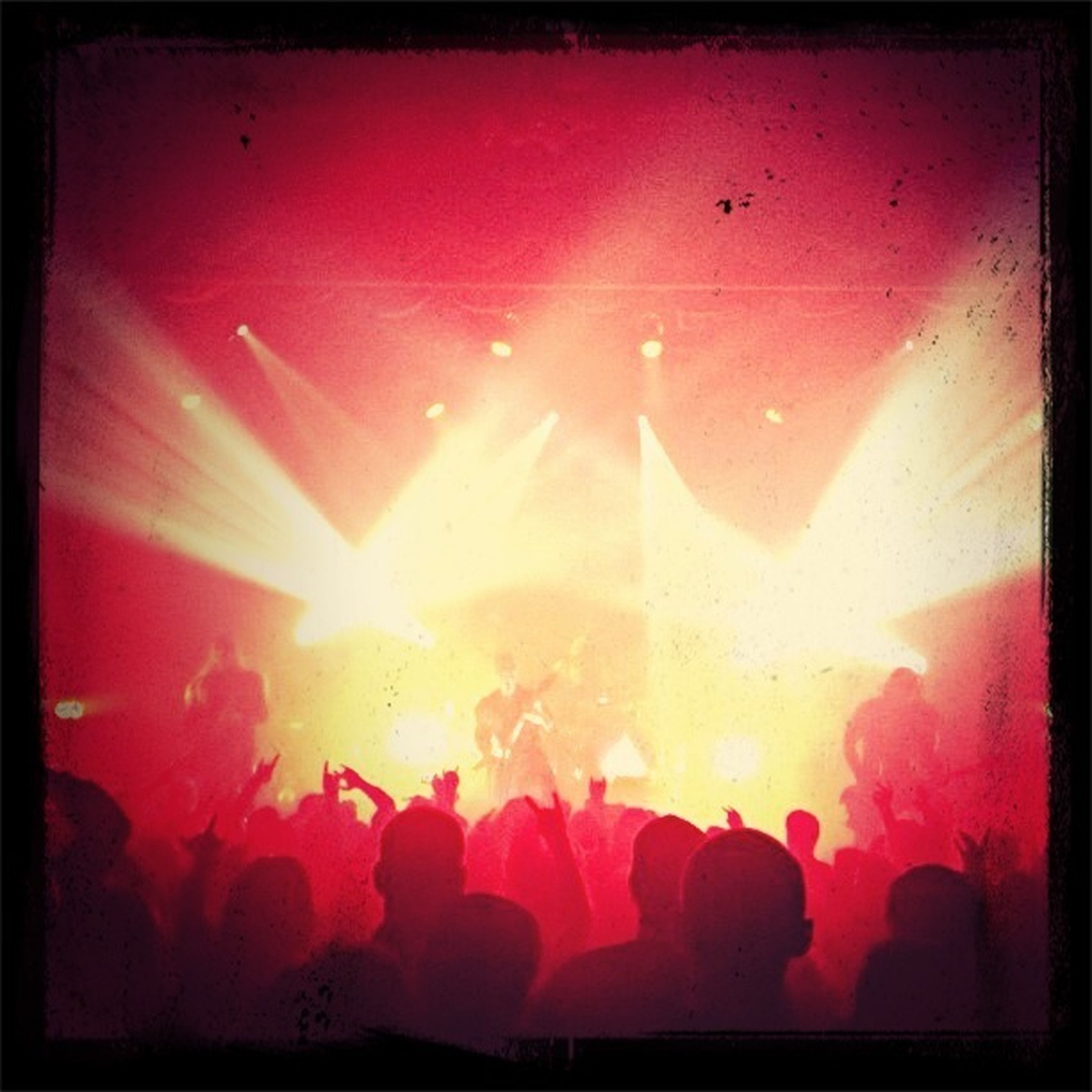 transfer print, auto post production filter, large group of people, indoors, illuminated, lifestyles, enjoyment, leisure activity, crowd, arts culture and entertainment, men, fun, person, event, night, light - natural phenomenon, celebration, silhouette, lighting equipment