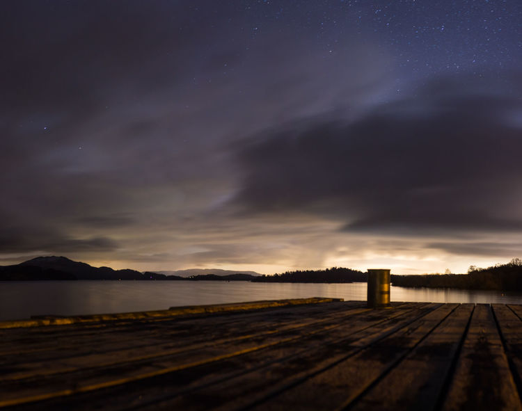 Anchor Point Cloudy Sky Loch  National Park Nature Pier Scotland Tranquility Trossachs National Park Barrel Boardwalk Dusk Lake Landscape Loch Lomond Luss Pier Mountains Night No People Outdoors Scenics Stars Walkway Wooden Planks
