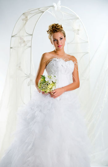 Beautiful cheerful bride indoors Romantic Summer Collection Summertime Beautiful Woman Blond Hair Bouquet Bridal Bridal Bouquet Bride Bunch Of Flowers Female Flowers Life Events Marriage  One Person Smile Studio Shot Summer Wedding Wedding Arch Wedding Dress Weding Women Young Adult Young Women