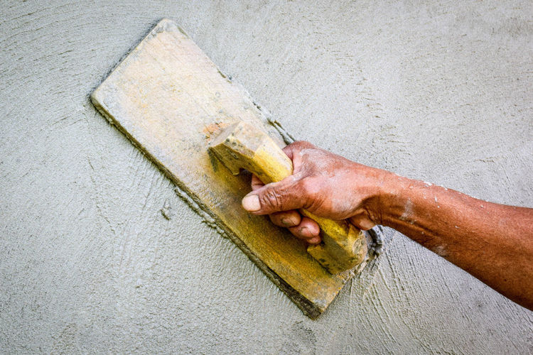 High angle view of man working on wall