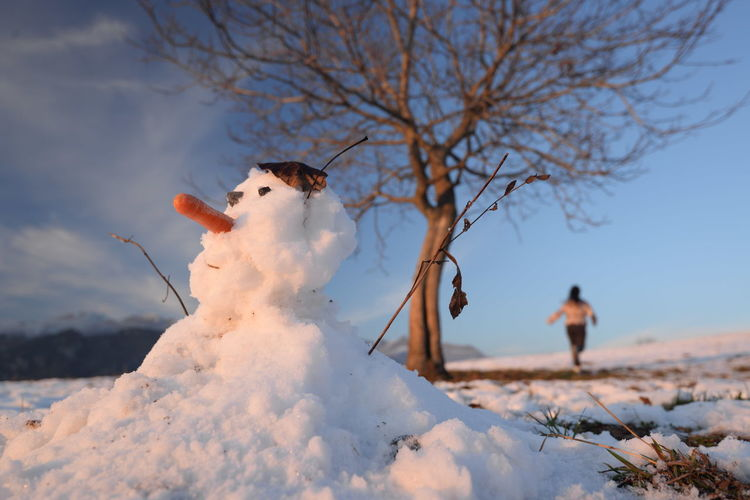 Full length of man with snow against sky