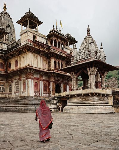 India Travel Photography Traveling Travelling Architecture Belief Building Building Exterior Built Structure Day Incredible India Lifestyles One Person Place Of Worship Rajasthan Real People Rear View Religion Spirituality Temple Traditional Clothing Travel Destinations Travelphotography