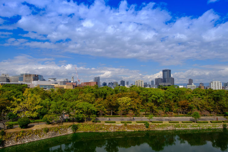 Beautiful forest , blue sky , city and lake beside Osaka castle OSAKA Osaka,Japan Sky Cloud - Sky Water Built Structure Building Exterior Nature Architecture Plant Reflection Tree City Building Waterfront No People Cityscape Outdoors Office Building Exterior Skyscraper Financial District  Lake View Reflection Landscape Japan
