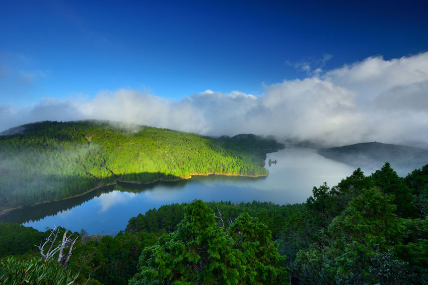 Beautiful natural landscape, the lake is quiet and picturesque. Broad Tranquil Lake Beauty In Nature Cloud - Sky Clouds Day Forest Green Color Green Lake Idyllic Lake Blue Landscape Macro Mountain Mountain Lake Nature No People Outdoors Scenics Sky Smoke - Physical Structure Tranquil Scene Tranquility Tree Water