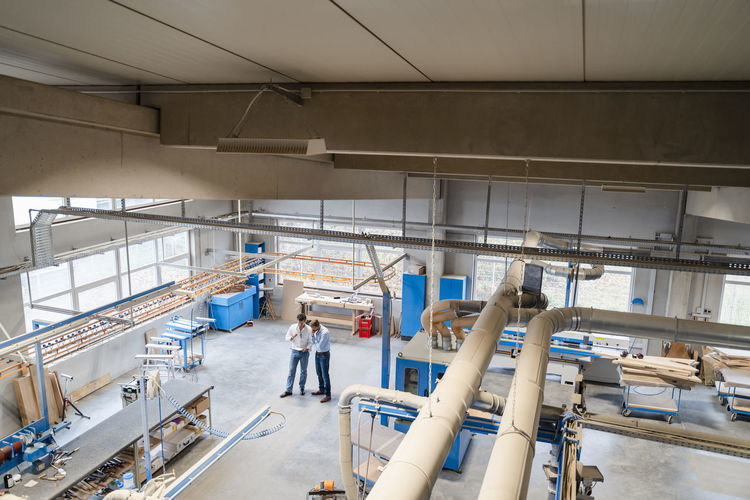 High angle view of people working in factory