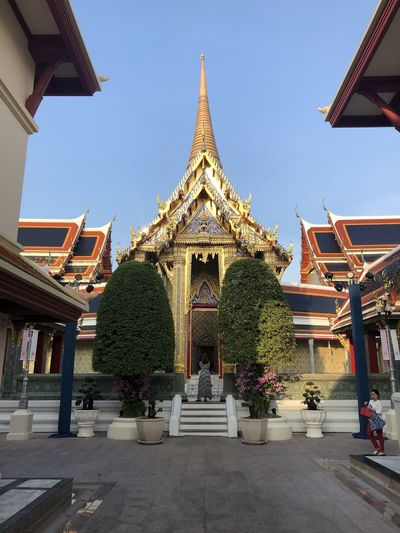 Facade of temple against building