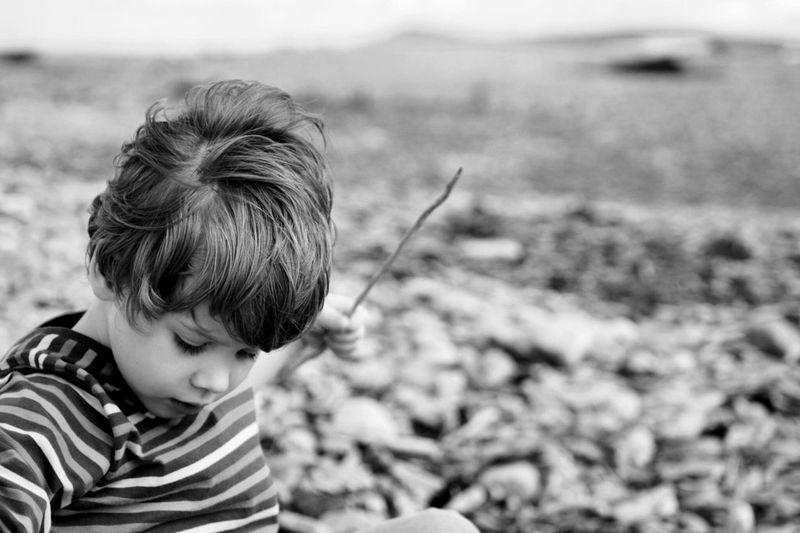 Cute Boy Playing Stick