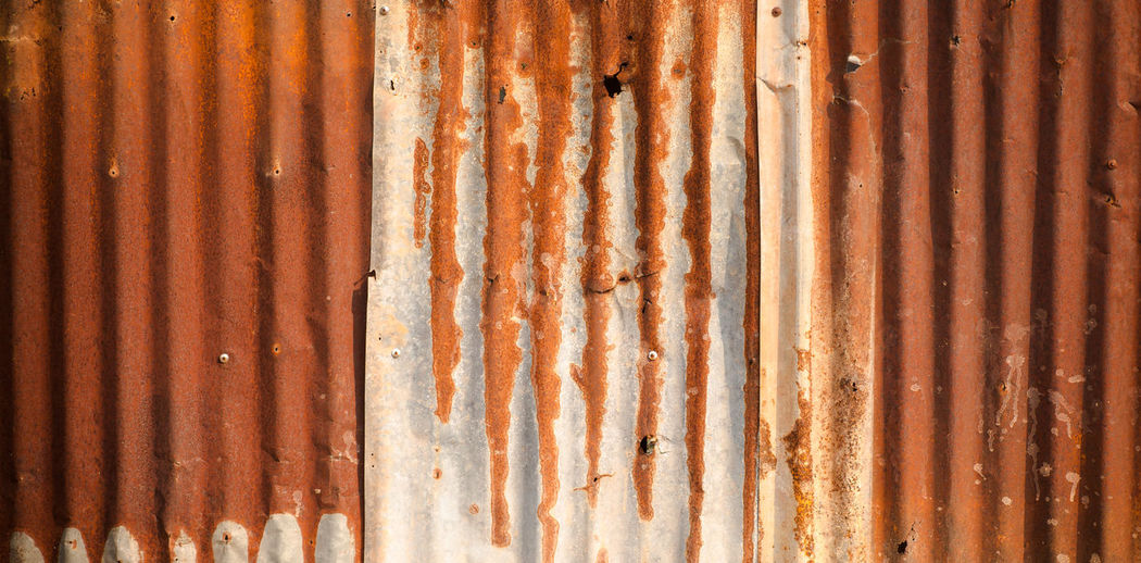 Rusty zinc plate wall for background Abstract Architecture Background Badly Brown Building Chrome Sepia Construction Corrugated Damaged Demolished Dirty Exterior Galvanize Galvanized Grunge Grungy Industrial Industry Material Metal Metallic Old Oxidized Panel Pattern Plate Plated Rough Ruined Rusty Scratch Seasoned Sheet Shiny Silver  Spot Stain Steel Striped Surface Texture Textured  Tin Wall Weathered Zinc