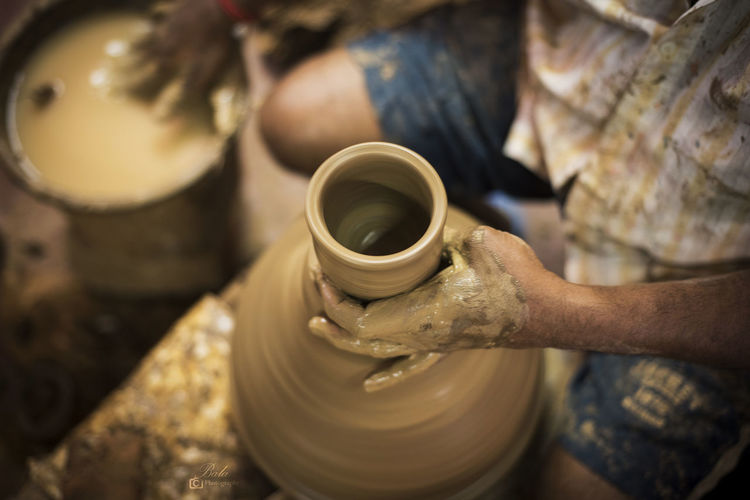 Shaping up the clay Pottery Craft Art And Craft Occupation Working Skill  Clay Human Hand Hand Expertise One Person Human Body Part Creativity Workshop Spinning Earthenware Craftsperson Ceramics Adult Indoors  Preparation  Mud Pitcher - Jug India Clay Work Hardwork