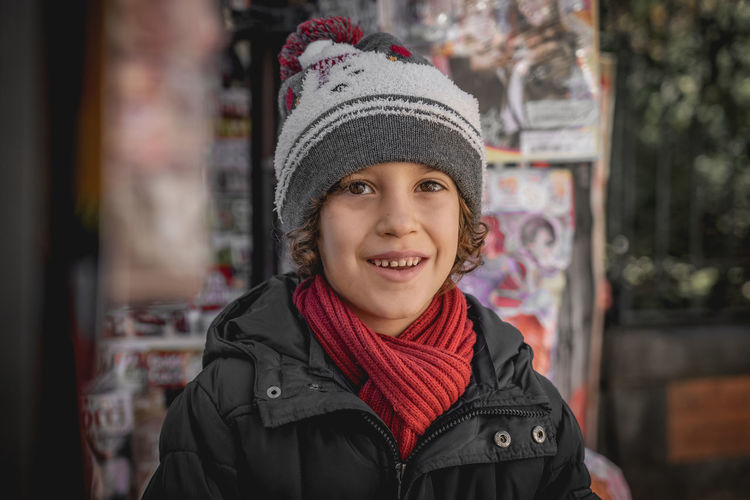 Portrait of a boy in winter Portrait Clothing Looking At Camera One Person Smiling Front View Knit Hat Hat Childhood Headshot Warm Clothing Happiness Winter Child Standing Real People Innocence Focus On Foreground Lifestyles Scarf Red Hat Cute Teeth 6 Years Old