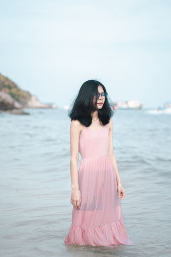 Young woman standing in sea