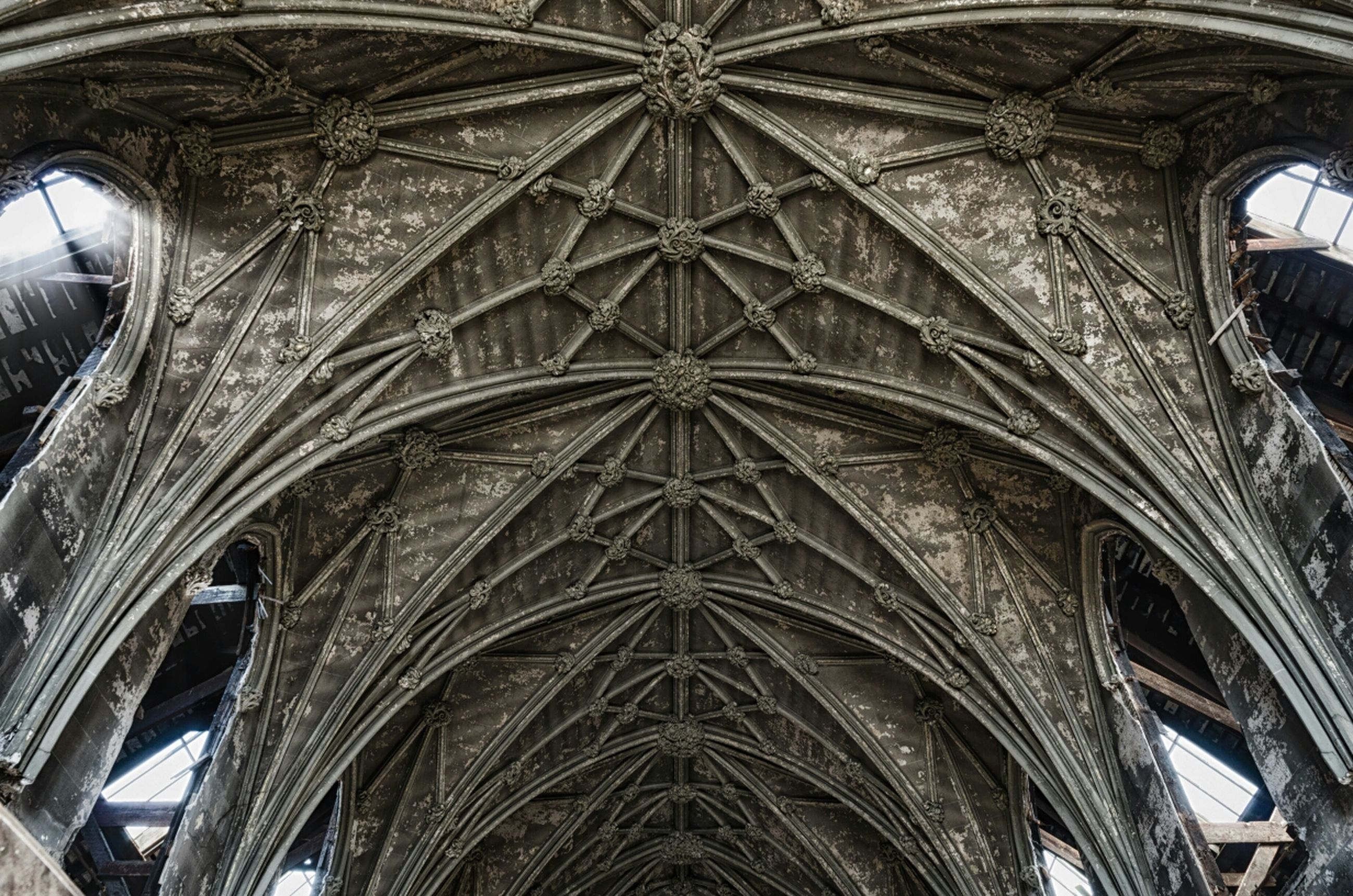 architecture, low angle view, built structure, place of worship, religion, arch, church, cathedral, spirituality, famous place, history, indoors, travel destinations, tourism, architectural feature, travel, ceiling, international landmark