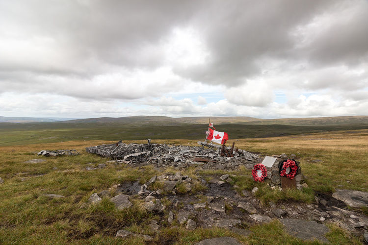The wreckage of a Canadian crewed Wellington Bomber MF-509, on the Black Mountain in the Western Brecon Beacons Black Mountain Brecon Beacons Canadian MF-509 Memorial Mf509 Plane Cloud - Sky Crash Site Flag Landscape Mountain Nature Outdoors Wellington Bomber Wreckage