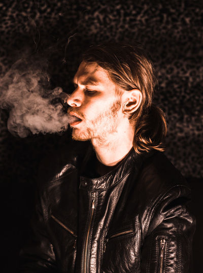 self portrait. One Person Young Adult Smoking - Activity Smoking Issues Bad Habit Young Men Cigarette  Jacket Portrait Lifestyles Clothing Looking Away Headshot Leather Jacket Hairstyle Leather Self Portrait Smoke Men Photography love yourself