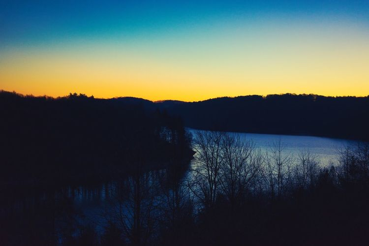 Tranquility Scenics - Nature Tranquil Scene Sky Beauty In Nature Water Silhouette Sunset Tree Lake No People Nature Plant Clear Sky Reflection Non-urban Scene Idyllic Environment Landscape Outdoors Romantic Sky Sunrise