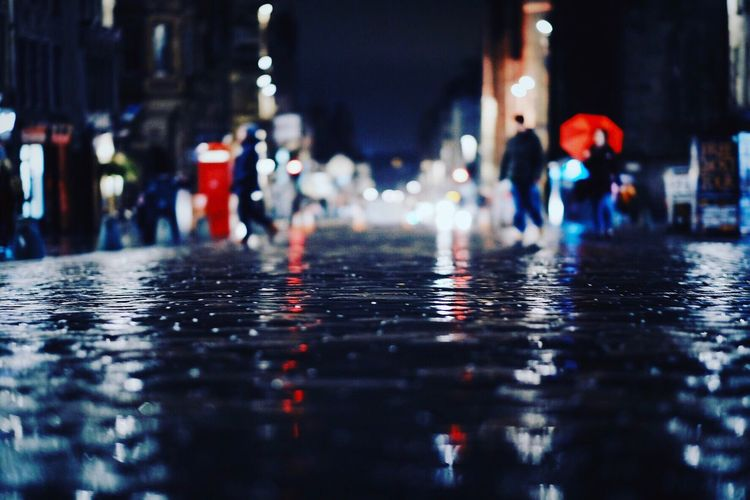 Close-up of wet illuminated water at night