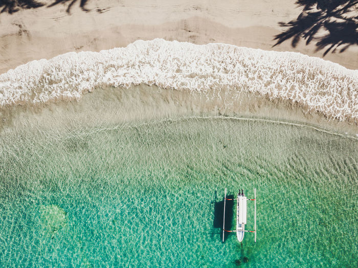 Aquatic Sport Beach Beachfront Beauty In Nature Day Flowing Water Grass High Angle View Land Motion Nature No People Outdoors Plant Scenics - Nature Sea Sport Sunlight View From Above Water Waterfront