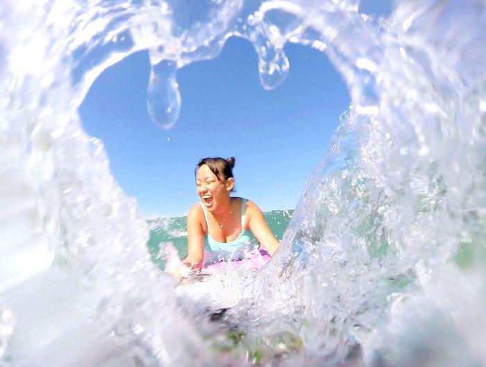 Smiling Woman Swimming In Sea