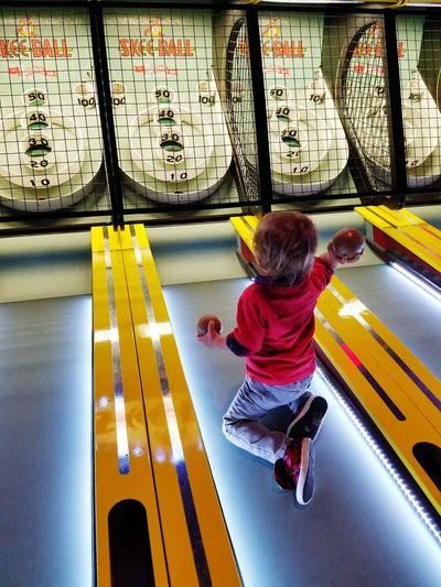 Skeeball That's One Way To Do It A Kids Life Childhood Child Playing Indoors  Amusement Parks Grandbaby Boys Will Be Boys Little Boy Lifestyles Fun Funny Moments Cheating Albuquerque New Mexico Samsung Galaxy S7 Edge Hello World Art Is Everywhere Simple Pleasures The Portraitist - 2017 EyeEm Awards The Street Photographer - 2017 EyeEm Awards Live For The Story Place Of Heart