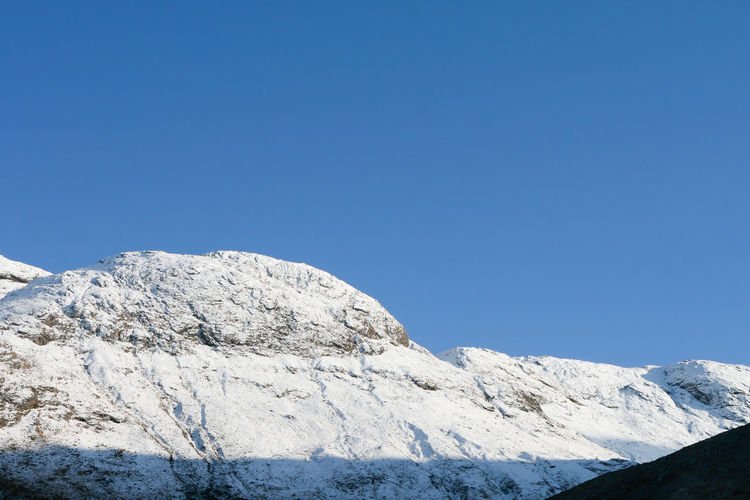 Ridge Line Ridge Line Beauty In Nature Blue Clear Sky Cold Temperature Copy Space Day Environment Glenfinnan Highlands Mountain Mountain Peak Mountain Range Nature No People Non-urban Scene Outdoors Ridge Scenics - Nature Sky Snow Snowcapped Mountain Tranquil Scene Tranquility Winter