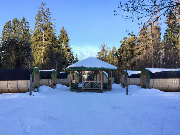 Snowy cabins on