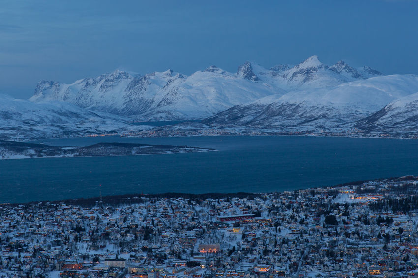 Arctic Beauty In Nature Blue City Cold Fjord Frozen Landscape Mountain Mountain Range Norway Outdoors Polar Night Residential District Scenics Snow Town Tranquility Troms Tromsø Water Winter