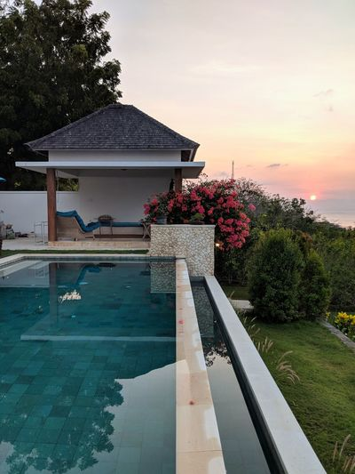 heaven on earth 353 Degrees North Villa Tropical Climate Island Swimming Pool Nature_collection Beauty In Nature INDONESIA Dusk Colours Peaceful No People Vacations Happy Blue Shadow Sunset_collection EyeEm Selects Water Tree Sky Architecture Landscape Pavilion Gazebo Calm Sunset Tranquil Scene Orange Color Tranquility Idyllic Scenics