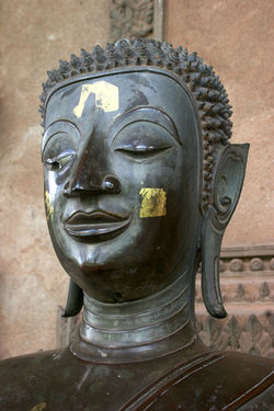 Face of Buddah statue. Vientiane, Laos. Buddah Vientiane, Laos Art And Craft Close-up Day Human Representation Indoors  Male Likeness No People Place Of Worship Religion Sculpture Spirituality Statue Strange Look
