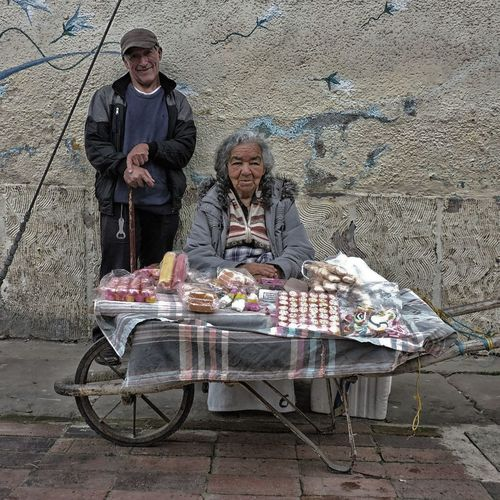 Colombia Old woman selling traditional candys in the street. Nemocón